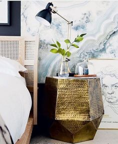 Pretty bedside styling. Love that gold side table and that caned bed.