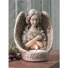 """Angel Memories - """"This beautiful angel votive will provide a peaceful feeling as a bereavement offering, or for a memorial gift. She makes a wonderful inspirational gift. The candle takes a standard tealight votive (included). Image is Aged, other options are Natural, Green, Terra Cotta and Designer White Dimensions: 5.75 x 4.75 x 3.50 Composition: hand cast stone """""""