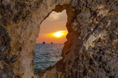 A hole in a rock at Boracay Island Philippines. Philippines People, Boracay Island, The Rock, This Is Us, Rocks, Asia, Boat, Community, Sunset