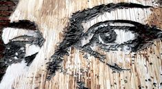 Alexandre Farto uses power tools to chip away pieces of walls to make his portraits on the sides of buildings. There's a video on the link.