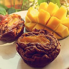 Nectarine Mango Muffins by tiu_lealishes! 1 cup vanilla Perfect Fit Protein, 1.5 cup chocolate Perfect Fit Protein, 2 mashed bananas, 1.25 cup egg whites, 1 whole egg, 1/4 cup almond milk, 1/4 cup water, 2 tbsp coconut oil, 3 tbsp almond flour, 2 tbsp ground flaxseeds, 1 tbsp baking powder, 1 tsp vanilla, 2 tbsp cinnamon, 2 nectarines, 1/3 mango. Mix all ingredients together until smooth. Fold in 1 nectarine & mango. Spray pan. Place nectarine slice in each.  Bake at 350 degrees for 20 minutes.