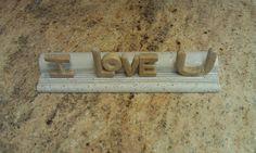 I Love U made from Tavertine and Limestone. 100% recycled stone products made in the USA. www.EcoGraniteGroup.com