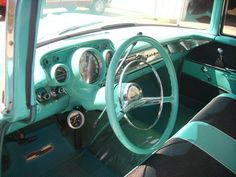 This was the exact color, upholstery and interior of my first car 57 Chevy