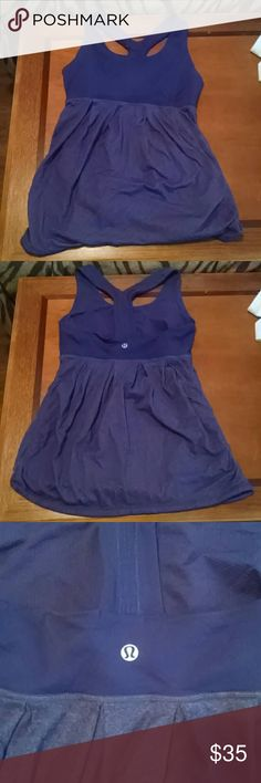 Lululemon purple workout top Basically brand new. Worn once. Perfect condition. Built in shelf bra lululemon athletica Tops