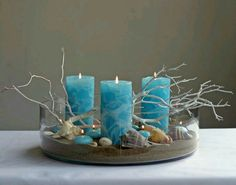 Beach centerpiece using blue pillar candles. Great Affordable Idea if you Stock … – Pillar Candles İdeas. Blue Beach Wedding, Seaside Wedding, Beach Weddings, Spring Wedding, Seashell Crafts, Beach Crafts, Blue Pillar Candles, Yellow Candles, Flameless Candles