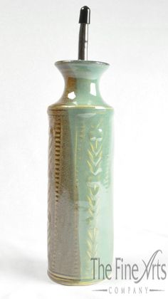This lovely pottery oil cruet will make dressing your salads a little prettier! Handmade in America by Holman Pottery. Pottery Designs, Pottery Ideas, Handmade Home Decor, Handmade Pottery, Ceramic Pottery, Pottery Art, Olive Oil Jar, Wine Coolers, Oil Bottle