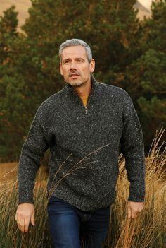 This Donegal Half Zip Sweater is a must have. The yarn used is spun in the famous Donegal Yarns Spinning mill in Kilcarra, County Donegal, Ireland. This Irish man's  Aran sweater comes to you knit in 100 % Donegal wool from our own spinning mill on the North West Coast. The wool has fleck throughout which gives it it's very own special character. This mans 100% Irish wool jumper has a half zip neckline which can be worn open or closed for extra warmth.