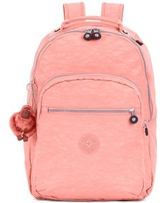 Life's a trip, so pack accordingly with this take-anywhere backpack from Kipling. Fashioned in sturdy, water-resistant nylon with plenty of pockets, it keeps books, laptop, Pda and other essentials sa