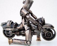 Buy an amazing motorcycle rider metal art sculpture | Find a sculpture within a huge collection of modern metal sculptures | Shipping worldwide 5-10 days  This beautiful art sculpture is an artwork representing Homo Motocycleticus. Human kind that evolved from motorcycles. It has been created only with recycled metal parts. This sculpture is an ideal indoor sculpture and a perfect wedding gift. It has been painted with varnish for rust protection. Metal Workshop, Used Engines, Metal Art Sculpture, The Fragile, Modern Contemporary, Carving, Artwork, 10 Days, Perfect Wedding