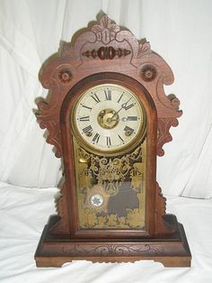 NICE ANTIQUE E N WELCH GINGERBREAD KITCHEN CLOCK WITH ALARM NICE PENDULUM.  21 INCHES TALL.