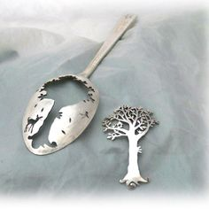 Recycled antique spoons transformed into wearable brooches.  Handmade in Cambridge.  This is the new tree brooch design for the Spring collection of Hairy Growler Jewellery.  Like every piece i make, this brooch is delicately handcrafted and made completely from recycled raw materials.  The spoon used on this particular brooch was sourced from Wood Green animal rescue charity shop just outside of Cambridge.  (a difficult place to visit as you want to leave with a van full of dogs.)