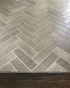 As a designer you have to think about all the little details. To me the transition from hard wood to tile is one not to overlook. Here's a detail from a stylish #aginginplace client. A simple piece of Schluter makes for a simple polished and relatively economical transition. And a Sonoma stone tile in herringbone pattern is a great non-slip option for a tile floor.