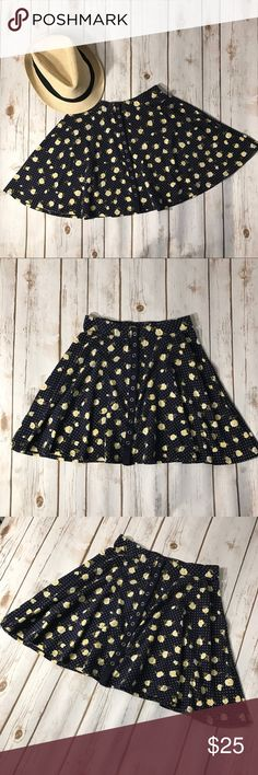 """Kimchi Blue Polka Dot with yellow Floral skirt Kimchi blue skater boy skirt with yellow Floral. Has front buttons closure. Size small but looks like it would fit an xs. No rips or stains. Measurements for flat lay: waist (22"""") length (14"""") Kimchi Blue Skirts Mini"""