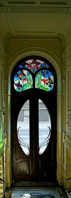 Stained glass circa 1906, Art Nouveau tenement door in Krakow, Poland.