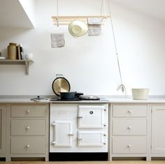 Very sweet.  A Shaker-Inspired Kitchen in London from deVol Kitchens.