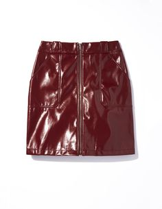 Wear Dorothy Perkins' rich red PU light-reflecting skirt with a tucked-in T-shirt, bare legs and ankle boots, covering with a classic beige trench when the weather shades.