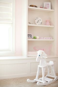built in shelves in white and pink