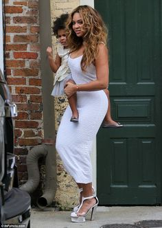 Beyonce wears slinky frock as she cradles Blue Ivy at Solange wedding #dailymail