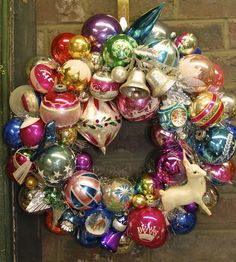 """""""Winter Wonderland"""" wreath by Glittermoon Vintage Christmas. Winter Wonderland  Gorgeous cool tones of pink, blue, silver & purple adorn this wreath.  There is a beautiful finial, a white celluloid deer, a blue bird and so many other fabulous vintage ornaments. Glittermoon Vintage Christmas: There will never be another like it."""