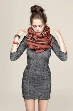 Love the: warm wooly body-con dress with the contrast of the bright infinity scarf, topped with a messy up-do. Chic and simple.