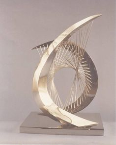 "Hyperbolic Paraboloid Arch Tall Short Rec Base (Sculpture) by Jerry Sanders This is a stainless steel sculpture with a stianless steel base. It is 29"" x 18"" x 14"""
