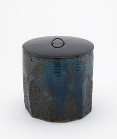 Iga ware tea ceremony water jar with faceted sides,19th century. Edo period or Meiji era. Stoneware with enamel glazes; lacquered wooden lid.