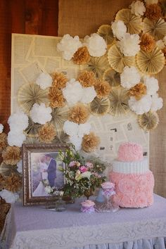 Backdrop made from the pages of an old dictionary, burlap, and coffee filter flowers.