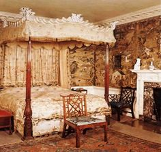 Chippendale four-poster bed circa 1755, carved cornice covered with yellow velvet at Corsham Court Mansion, Wiltshire, England