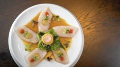 Naoki's sashimi plates are arranged in a starfish pattern and sparingly seasoned, reports Chicago Tribune's Phil Vettel. The flavor and mouthfeel are beautiful. (Brian Cassella / Chicago Tribune)