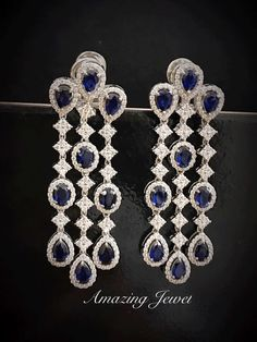 These long earrings with blue stones makes you feel royal and adds charms to your look. #amazingjewel #sterlingsilver #earring #fancycuts #festivemood #festivewear #worldwideshipping #onlineshopping #destinationweddingjewelry #bridalwear #usa #india #bahrain #oman #muscat #istanbul #jakarta #indonesia www.amazingjewel.com Call: 91-77422-99893 Pearl Jewelry, Antique Jewelry, Jewelery, Vintage Jewelry, Festival Wear, Blue Topaz, Diamond Earrings, Blue Stones, Muscat