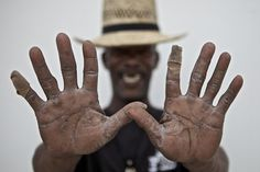 The hands of Pat Thomas, bluesman and son of bluesman James Son Thomas. Leland, MS. Photographer Lou Bopp
