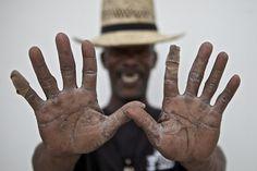 The hands of Pat Thomas, bluesman and son of bluesman James Son Thomas. Leland, MS. Photographer Lou Bopp