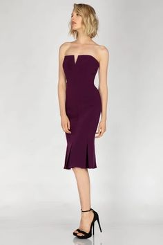 Woven strapless, midi dress with pleated trumpet skirt hem. Boned bodice Silicon rubber tape at top edge V-boning for front notch and v-back Center back invisible zipper Color: Eggplant Purple