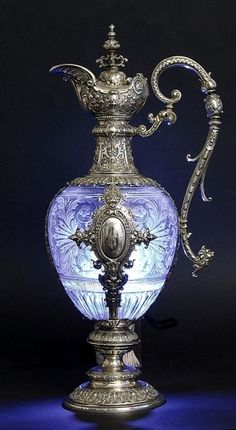 very fancy.♥❤♥ I would be concerned about putting hot liquids in this wouldn't you?***UPDATE***Finally have the correct info for this beautiful piece. *GERMAN SILVER AND CLARET JUGS, Bruckmann - Heilbronn, ca. Perfumes Vintage, Antique Perfume Bottles, Vintage Bottles, Vintage Glassware, White Dogs, Antique Glass, Antique Silver, Art Antique, Antique Jewelry