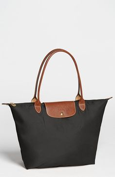 The original Longchamps Pliage tote has been a staple in our wardrobes for 15 years. Lightweight, folds small for travel, and never goes out of style.
