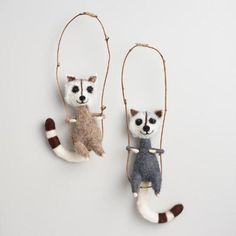 Our playful raccoon ornaments are handcrafted of wool and ready for holiday hijinks. The set of two comes in brown and gray with striped tails, bendable arms and mischievous smiles.