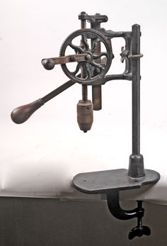 Hand-operated bench-mount drill press - There was one of these in the old shop area behind the chicken coop on the farm.