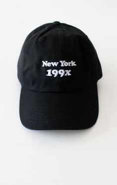 - Description Details: Black six panel cap with 'New York 199x' embroidery & adjustable back with tri-glide buckle. Brand: NYCT Clothing. 100% Chino Twill. Imported. All accessories are final sale. Si