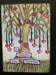 I found an image like this on Pinterest  I liked it so much I sketched the tree and string of hearts on water color paper.  I used water and Faber Castell Gelatos for the coloring.  Tim Holtz ChitChat words.