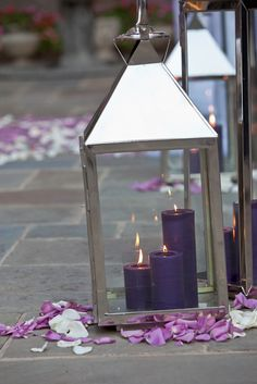 Lanterns with candles and flower petals. For lining aisles.