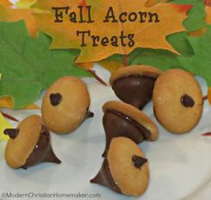 """Fall Acorn Treats ~  These are so cute and PERFECT for putting out during any fall gathering. These are NO BAKE! The most you have to do is melt some chocolate!  You Need: >1 Box of Mini Vanilla Wafers (or Mini Nilla Wafers) >1 Bag of Hershey's Kisses >1 Bag of Nestle Mini Morsels (for the stem and the """"glue"""").  Directions @: http://modernchristianhomemaker.com/quick-and-easy-fall-acorn-treats/"""