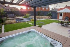 Garden with hot tub and pergola