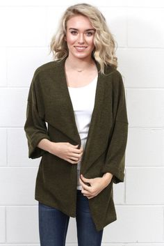 Super soft to the touch, this lightweight knit kimono cardigan is sure to be a staple in your closet this fall! Loose, oversized fit. Kimono sleeves hit about three quarter length.