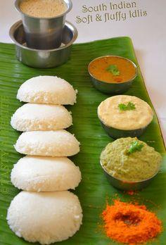 Idlis, sambhar and chutneys on a banana leaf served with 'tumbler' coffee.