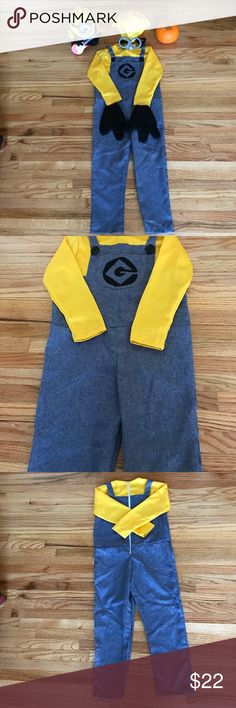 Minion Costume Have to love those cute minions! EUC. Boy's Halloween or pretend dress up costume! Size: Small. Fits a 5-6 year old might fit a 7 year old if child is on the short side. Back zip closure one piece outfit. Functional pocket. Comes with plastic hair, Adjustable goggles, A pair of black gloves. NO TRADES. Costumes Halloween