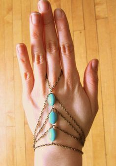 Turquoises Handpiece - Bronze. Amazing bronze hand chain featuring three turquoises at center and an adjustable lobster clasp closure at wrist. The perfect statement piece to go with a minimal look!