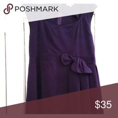 Vintage Purple Dress size 3xl Worn once as a bridesmaids dress. Flare dress with a cute bow at the waist. Tag says 4xl but it was altered to fit as it was too big in the bust for me. My measurements at the time were 38C for bust and 52 inches for waist. Lindy Bop Dresses Midi