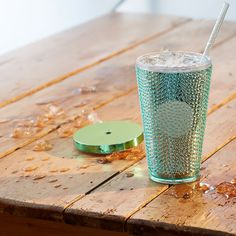 A Starbucks double-walled acrylic Cold Cup in sea foam green with a cool beaded texture. / 16 fl oz.