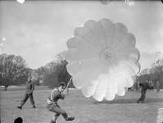 The first step in the training of parachutists is the correct way to land. At this Polish Parachute Training Centre at Largo House, Fifeshire, soldiers of the 1st Polish Independent Parachute Brigade are seen receiving their initial instruction in landing. From this they carry on through the various stages of the course to energe finally as fully fledged paratroops. 1942-03-14