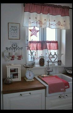 I like how the counter tops wedge under the sink. Pretty colors. Red and white look so fresh in a farm style kitchen.